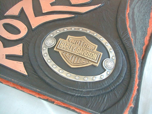 inset Harley-Davidson belt buckle in black leather book cover with copper name