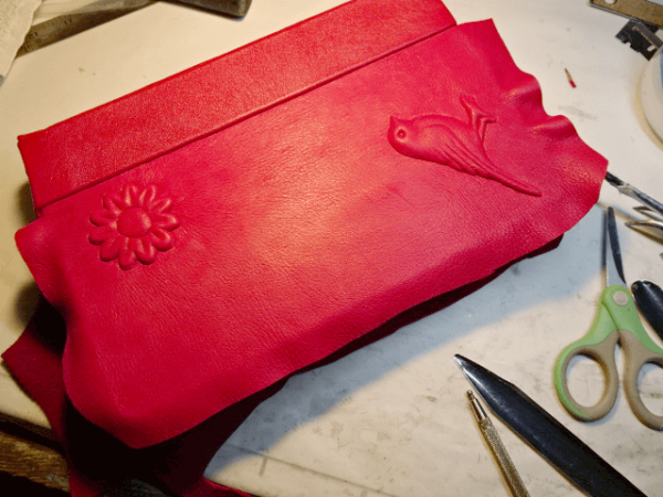 In-Progress image - Carved Embossed Bird and Flower on back cover of a Custom Leather Red Bible