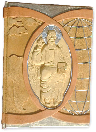handcarved yellow leather embossed jesus christ on custom Catholic Lectionary book with globe
