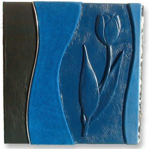 blue leather three ring binder with handcarved and embossed tulip on the cover