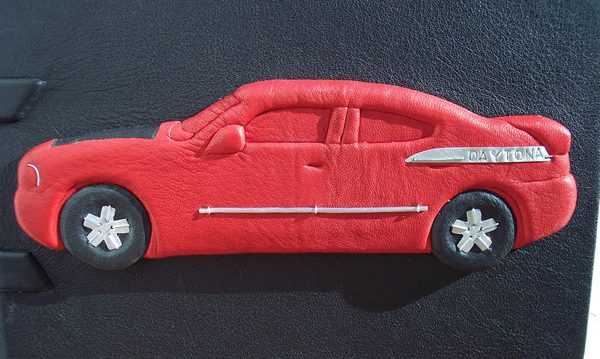 leather wrapped carved car on book cover