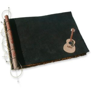 Black leather scrapbook with guitar string and twig binding, plus leather Gibson guitar art