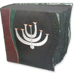 Silver and copper Menorah artwork in custom leather book cover for Rabbi