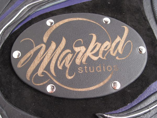 riveted laser etched business logo