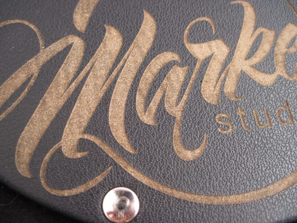 riveted laser etched logo close-up