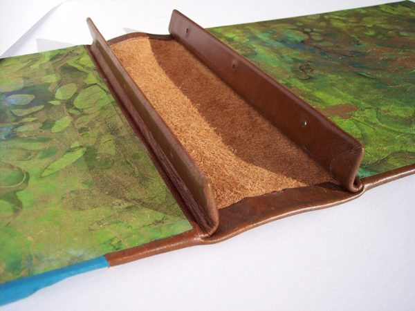 interior of screwpost book with brown leather spine hidden tabs
