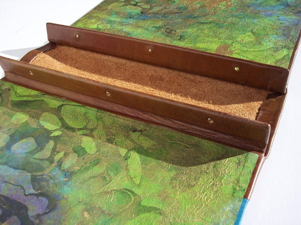refillable leather screwpost book with hidden internal tabs, marbled paper endsheets