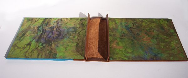leather screwpost book interior with covered spine, marbled endsheets