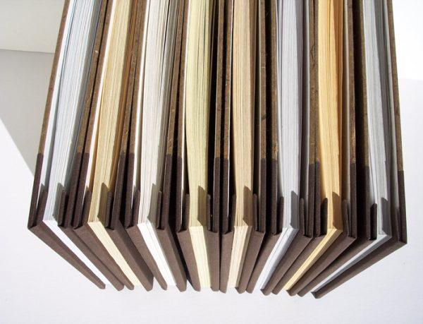 set of 8 screwpost books showing interior folded edge hidden screwpost tabs