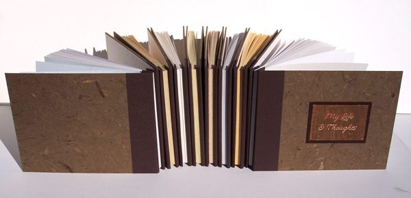 set of 8 refillable expandable memoir books with engraved metal plate, screwpost binding, fabric spines