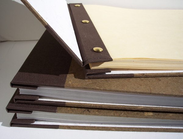brass screwpost bindings on brown fabric refillable and expandable books