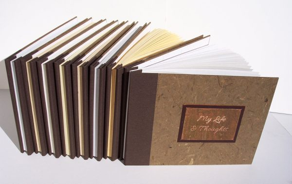Set of 8 custom biography books with engraved metal plate and screwpost binding