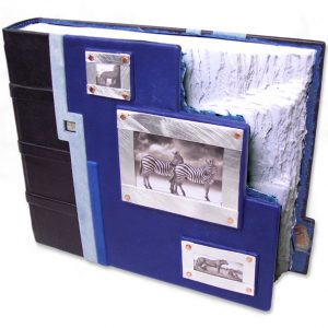 Stepped Photo Window Book with three silver framed slide-in photograph windows and odd shaped blue leather book cover