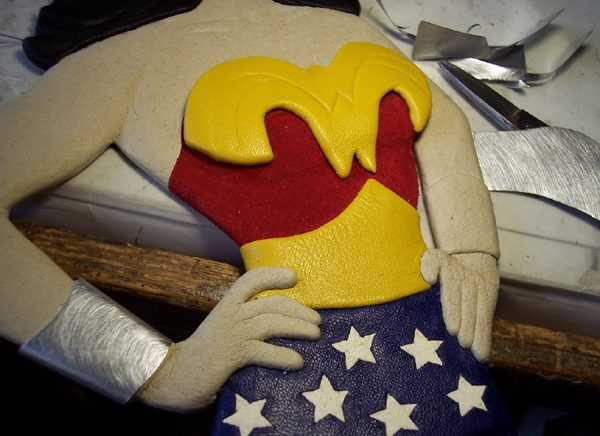 Wonder Woman bullet deflecting bracelets and wonder woman logo on leather figure in progress