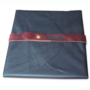Soft black leather portfolio folder wrapping a book, business logo branded onto a snapped belt