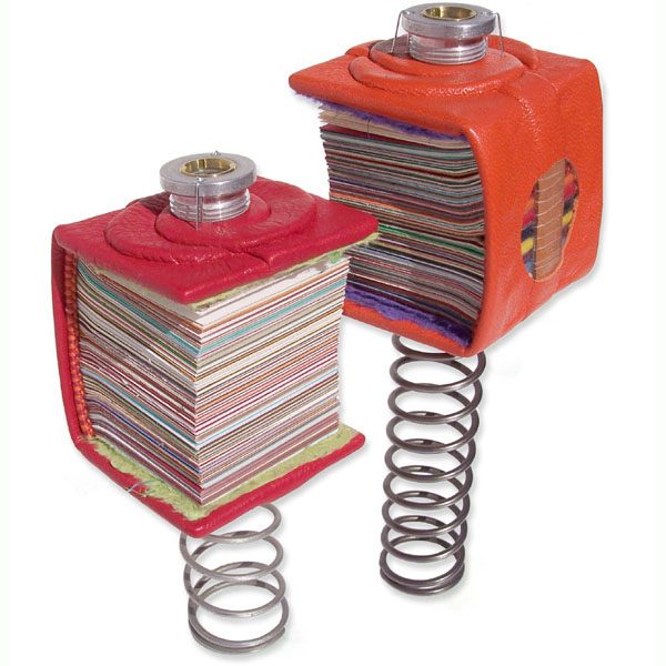 Miniature leatherbound Bouncing Books on truck springs