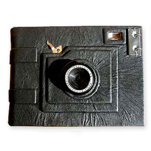 Camera shaped Photo Album using a camera lens and parts over black leather