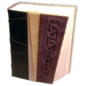 Purple suede Leather Journal with a carved embossed Celtic Knot and slanted paper edge