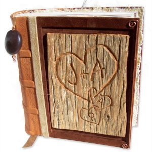 Carved Tree Bark Album | Leatherbound anniversary book with carved heart on tree truck bark