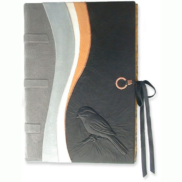 Chickadee Thesis Book with carved and leather embossed bird on custom book cover
