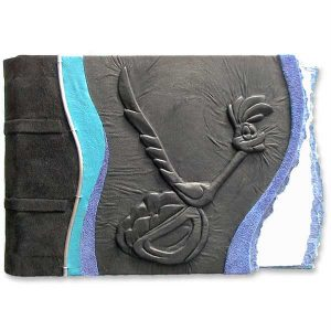 Leatherbound Roadrunner Scrapbook Album with carved roadrunner embossed under black leather