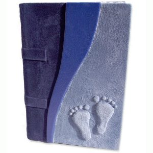 blue suede baby footprints embossed on leather book cover with two dark blue accents