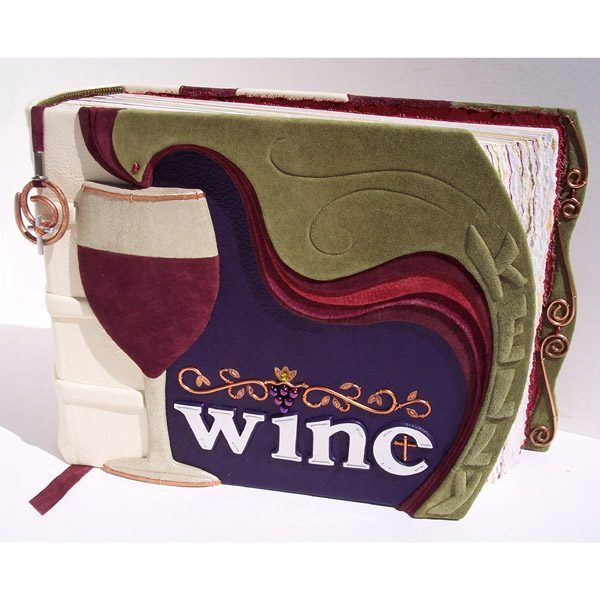 Wine logo on personalized leather photo album with carved wine glass, cross, and embossed name Kelly