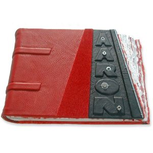Red Baby Album with Car Parts, embossed name under black leather, and sloped edge
