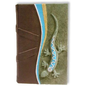 leatherbound blank journal with handcarved and embossed lizard on cover in green, turquoise, and black leather