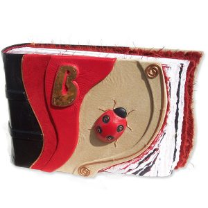 Ladybug Scrapbook Album with leather wrapped ladybug, copper legs and swirls, and Initial B