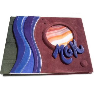 stained glass window as Jupiter in leather book cover with blue initials