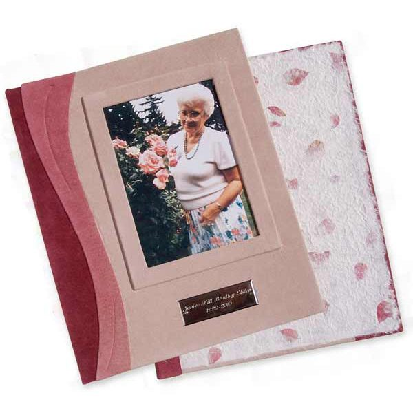 Engraved Name Plate Book book with pink leather, photo of woman with roses, an etched silver name plate, and handmade paper endsheets with flower petals in screwpost book