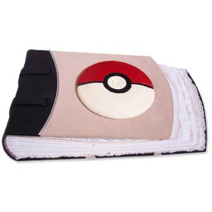 handcarved and leather wrapped convex pokeball on suede pink leather scrapbook album, red and white leather pokeball