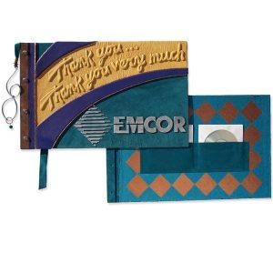 Screwpost Binding Leather Book for Retirement gift, Emcor metal capped logo, embossed yellow lettering, Cd pockets inside back cover, copper bookmark
