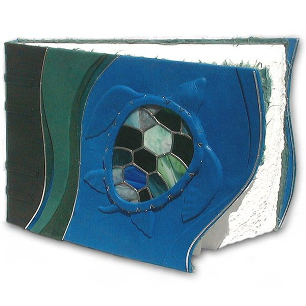 leaded stained glass window as turtle shell on carved embossed artwork on leather scrapbook cover