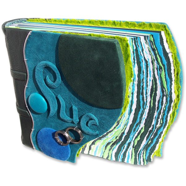 Turquoise embossed leather name Sue on personalized photo album
