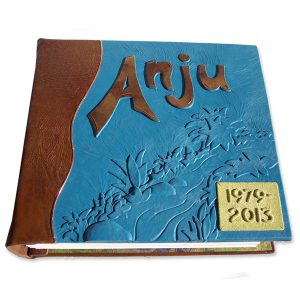 Custom Leather Memorial Book screwpost binding, embossed turquoise leather nature scene