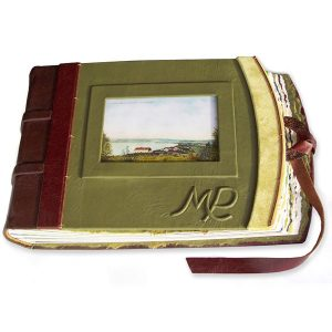green leather photo album with photo under glass, embossed initials, leather lace closure