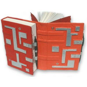 dos-a-dos back to back tandem books in orange and red leathers with pen closures and silver mosaic patterns