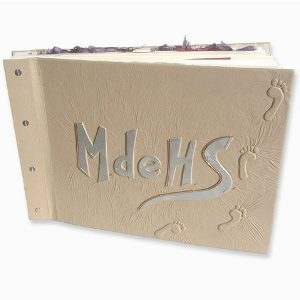 Beige leather scrapbook with brushed silver capped embossed initials and 3-D footprints on screwpost scrapbook