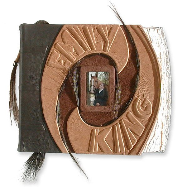 equestrian scrapbook in brown leather with horsehair, framed photo of horse and girl under glass, embossed lettering Emily and King