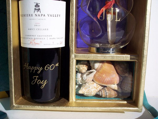 Etched Wine bottle, decanter, and shells in leather showcase box
