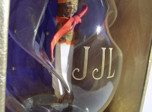 Etched glass decanter in leather box