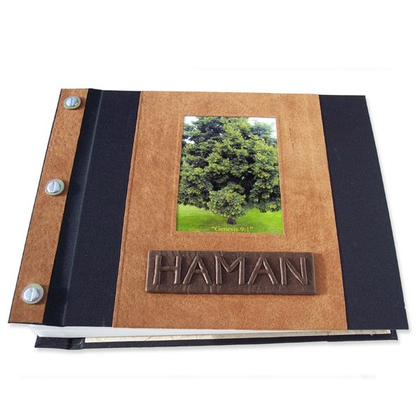 Refillable leather and fabric screwpost bound book covers with tree photograph and embossed lettering Haman on name plate
