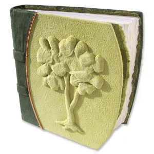 handcarved Embossed Tree Journal under suede lime green leather on blank nature themed journal