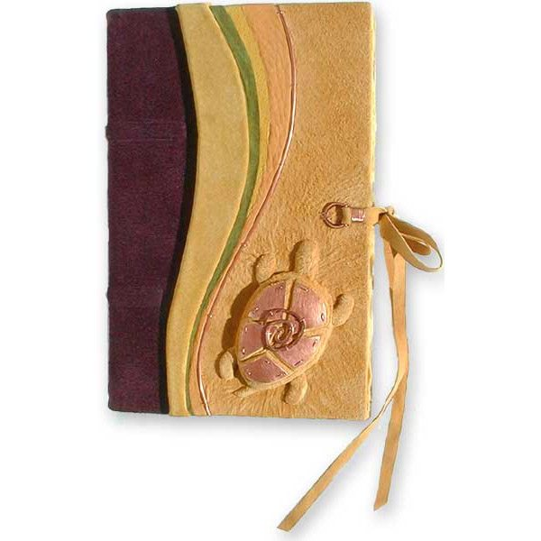yellow leather handbound journal with carved embossed pond turtle with copper mosaic shell and leather lace tie closure