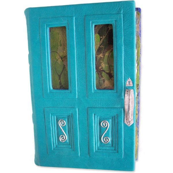turquoise leather door shaped black journal with glass windows and silver hardware