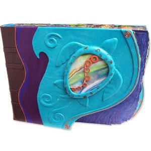 stained glass sea turtle windows in turquoise leather photo album with copper S curve and curved deckled edge blue pages