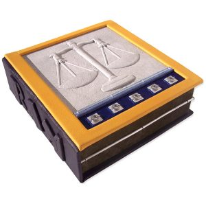 custom leather box with scales of justice embossed under white leather, gold frame