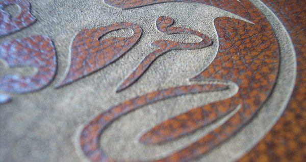 Laser Etched Logo on leather book cover, closeup